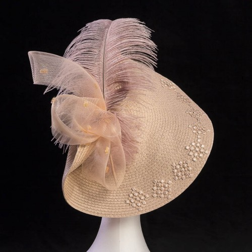 Tocado rosa con pluma ideal para boda día
