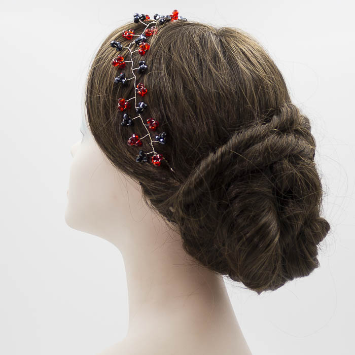 Tiara negra y roja para invitada boda